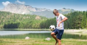 Soccer boy mountains